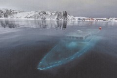 A ghostly boat submerged beneath the water of a lake